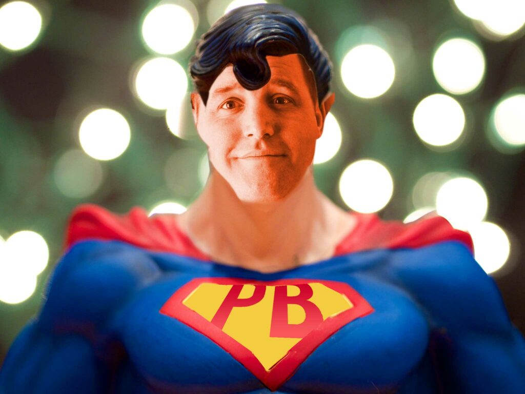 """A remix image of Superman aka Man of Steel with face replaced with a photo of Steel Wagstaff and the """"S"""" logo changed to """"PB"""""""